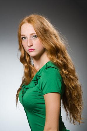 female leprechaun: Young woman wearing green dress