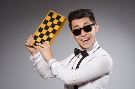 chess player: Funny chess player with board