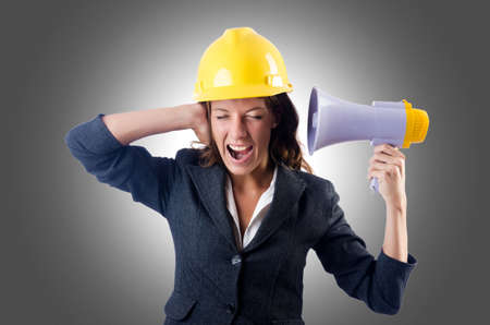 Female construction worker with loudspeaker photo