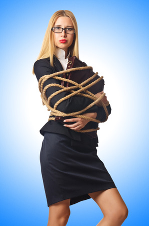 Woman businessman tied up with rope photo