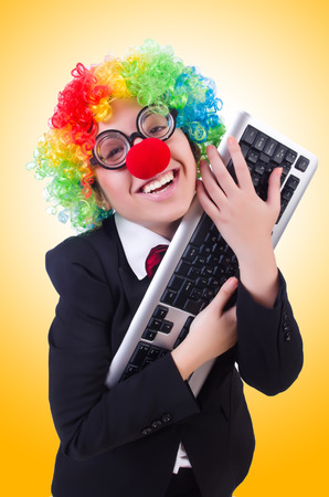 Funny clown with keyboard on white photo