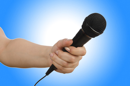micro recording: Hand with microphone on white