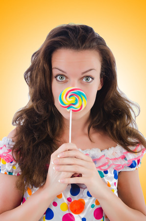 lolli: Woman with lollipops isolated on white
