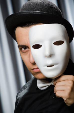 comedic: Funny concept with theatrical mask Stock Photo