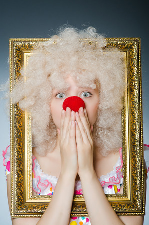 buffoon: Funny clown with picture frame Stock Photo