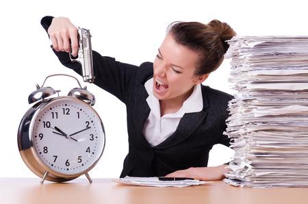 under pressure: Woman with gun under stress from deadlines