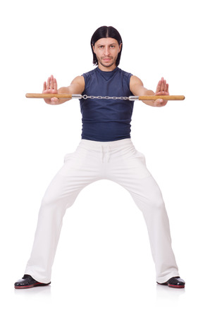 karate fighter: Funny karate fighter with nunchucks on white Stock Photo