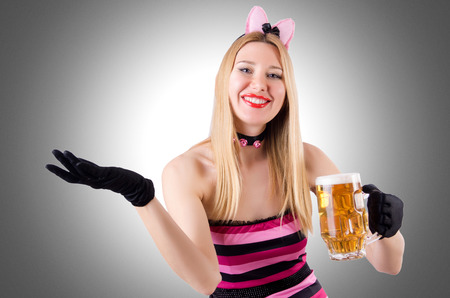 Woman with beer isolated on white photo