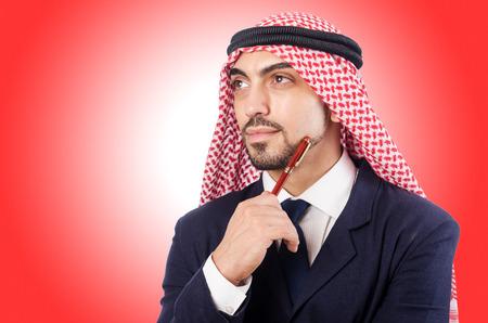 kandura: Arab businessman isolated on the white Stock Photo