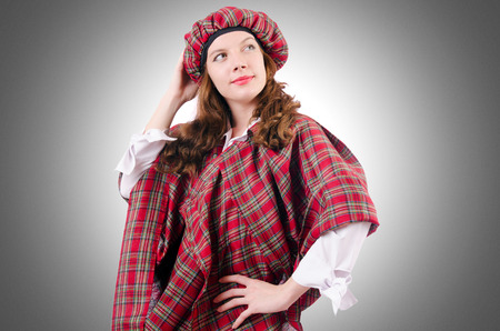 scot: Young woman in traditional scottish clothing