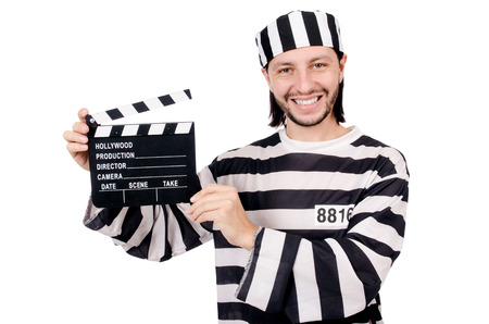 inmate: Funny prison inmate with movie board isolated on white Stock Photo