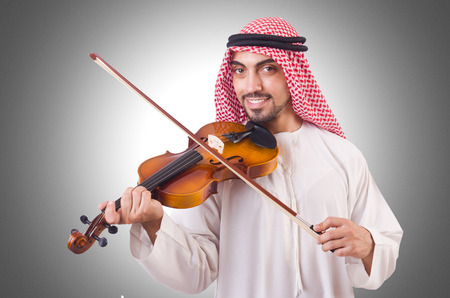 solo violinist: Arab man playing music on white