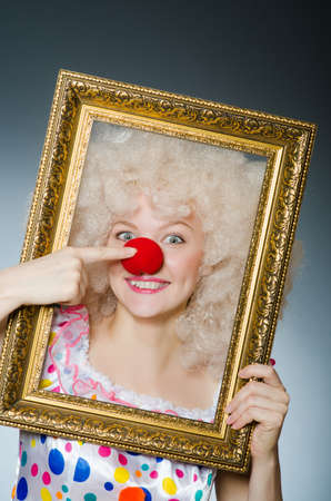 pierrot: Funny clown with picture frame Stock Photo