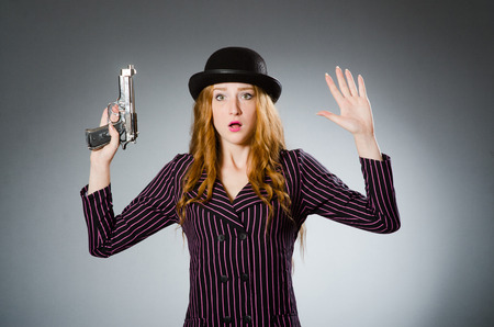 Woman gangster with gun in vintage concept photo