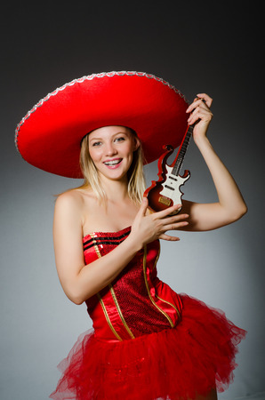 Woman wearing sombrero hat in funny concept photo