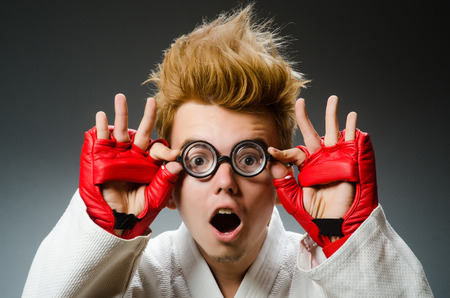 Funny boxer in sport concept photo