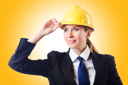 safety helmet: Young businesswoman with hard hat on white