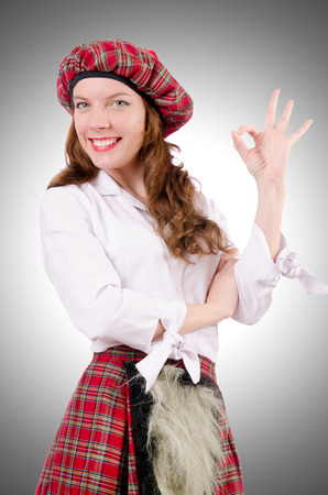 sporran: Young woman in traditional scottish clothing