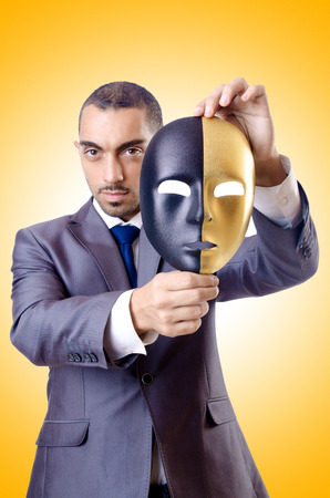 hypocrisy: Businessman with mask in hypocrisy concept Stock Photo