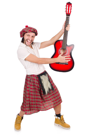 sporran: Scotsman playing guitar isolated on white