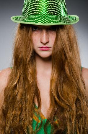 Young woman wearing green dress photo