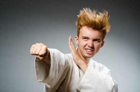 karate fighter: Funny karate fighter wearing white kimono Stock Photo