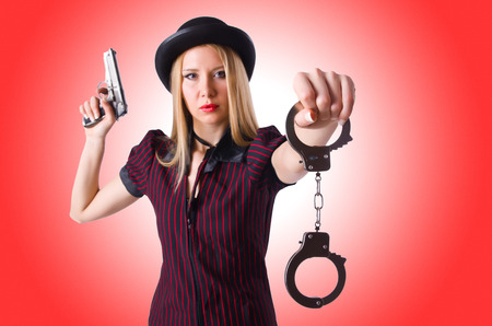 cuffs: Woman gangster with gun and money Stock Photo