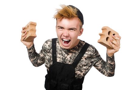 Funny soldier in military concept isolated on the white photo
