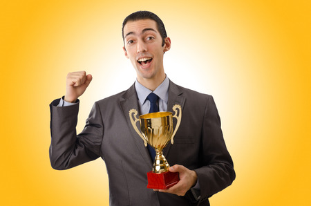 awarded: Man being awarded with golden cup Stock Photo