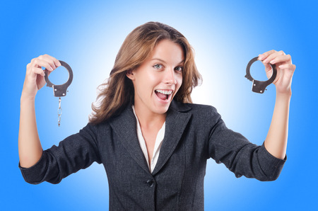 handcuffs female: Female businesswoman with handcuffs on white