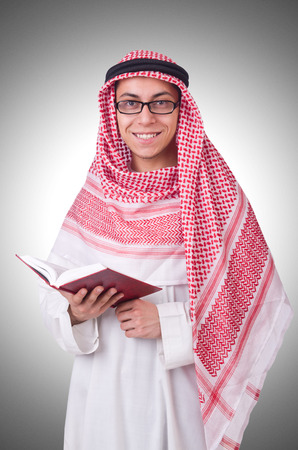 coran: Young arab man isolated on white Stock Photo