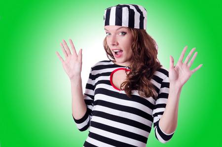 lawbreaker: Convict criminal in striped uniform Stock Photo