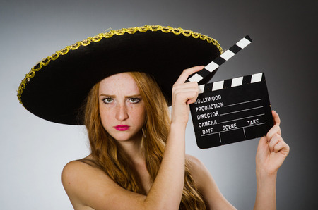 clapboard: Funny mexican woman with sombrero and movie clapboard