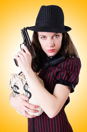 female assassin: Woman gangster with handgun on white