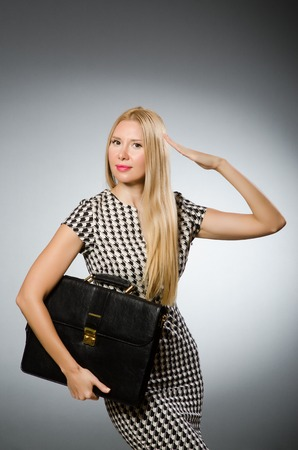 Businesswoman in business concept  with briefcase photo