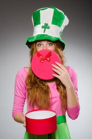Woman wearing saint patrick hat photo