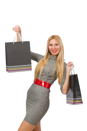 Woman with many shopping bags on white photo
