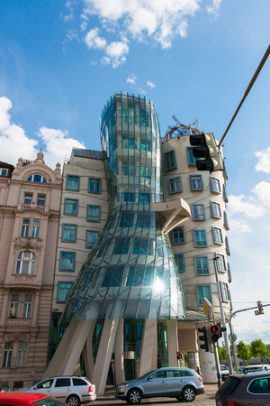 dancing house: Prague - MAY 9, 2014: Dancing House on May 9 in Prague, Chech Republic. Dancing house is one of the most popular tourist attractions in Prague Editorial