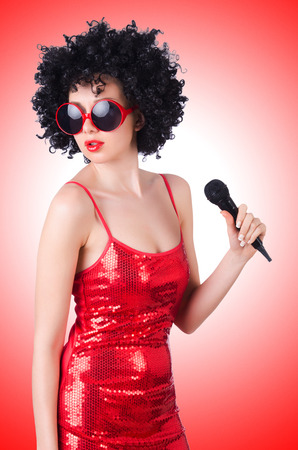 pop star: Pop star with mic in red dress on white Stock Photo