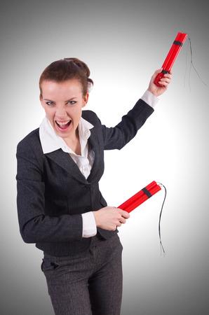 Businesswoman with dynamite on white photo