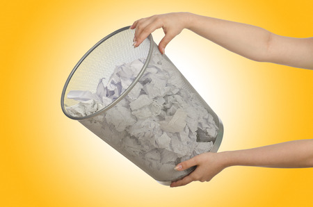 wastepaper: Hands with garbage bin with paper