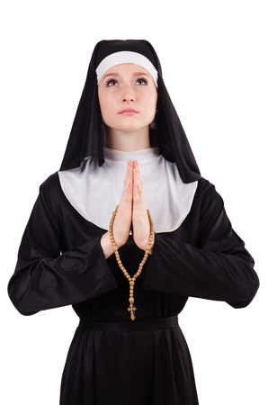 profess: Young praying nun with beads isolated on white