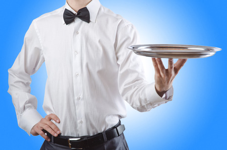 waiter: Young waiter with silver tray Stock Photo
