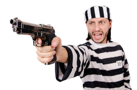 lawbreaker: Prison inmate with gun isolated on white