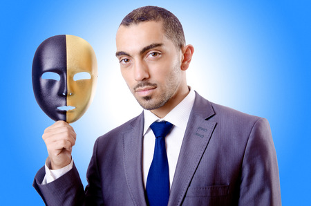 hipocres�a: Hombre de negocios con la m�scara de hipocres�a en concepto Foto de archivo
