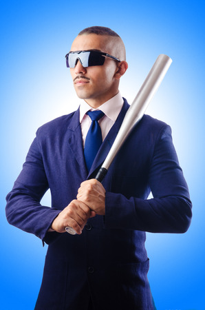 homerun: Handsome businessman with bat on white Stock Photo