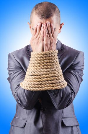 gefesselt: Gesch�ftsmann mit einem Seil gefesselt Lizenzfreie Bilder