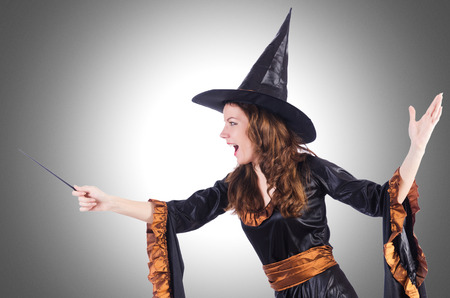 Witch with wand isolated on the white Stock Photo