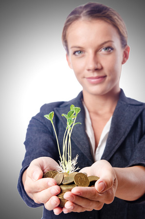 protect money: Businesswoman with seedlings and coins Stock Photo