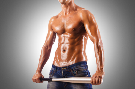 Muscular man with baseball bat photo